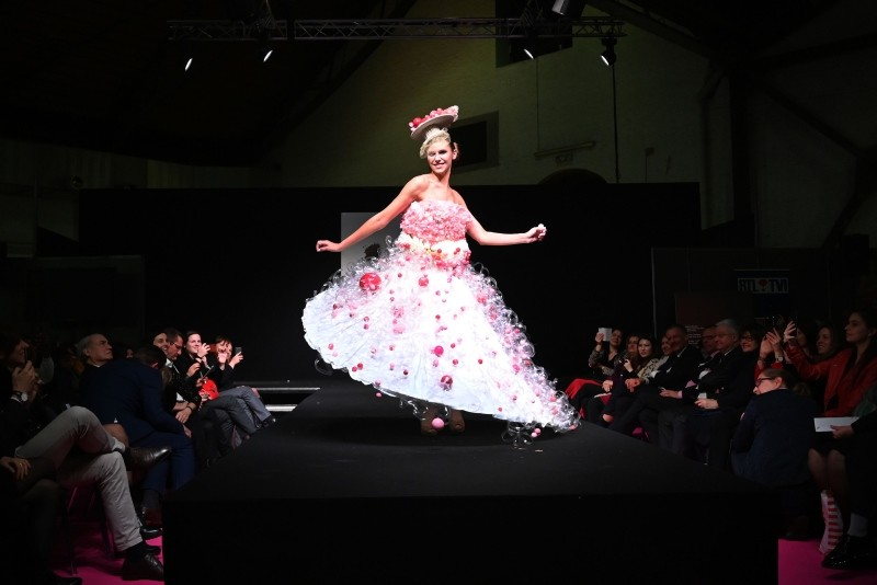 A model presents a chocolate-made dress creation during a fashion show of clothes made out of chocolate for the inaugural night of the sixth Chocolate Fair in Brussels, on February 21, 2019.