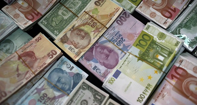 In this Monday, June 8, 2015, file photo, Turkish liras, euros and U.S. dollars are stacked at a currency exchange office in Istanbul, Turkey. (AP Photo)