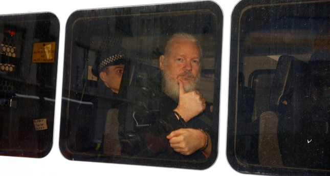 WikiLeaks founder Julian Assange is seen in a police van after was arrested by British police outside the Ecuadorian embassy in London, Britain April 11, 2019. Reuters Photo