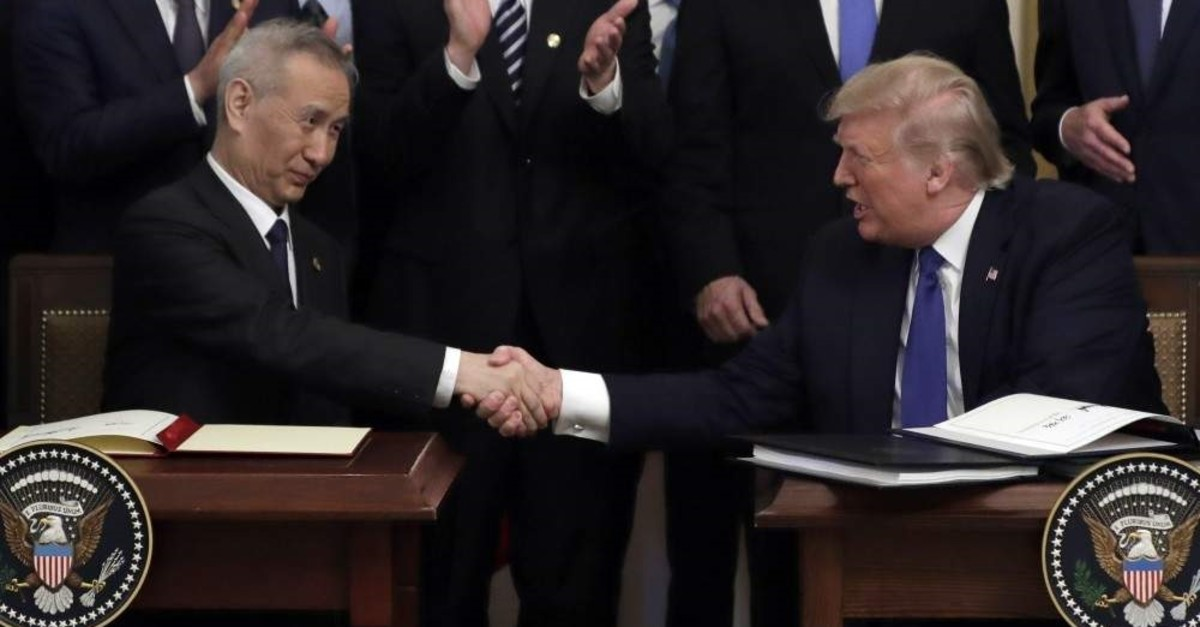 President Donald Trump shakes hands with Chinese Vice Premier Liu He, after signing a trade agreement in Washington, Jan. 15, 2020. (AP Photo)