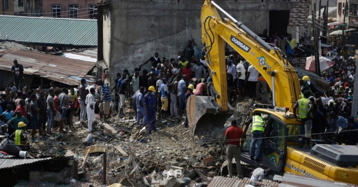 Emergency services attend the scene after a school building collapsed in Lagos, Nigeria, Wednesday March 13, 2019. (AP Photo)