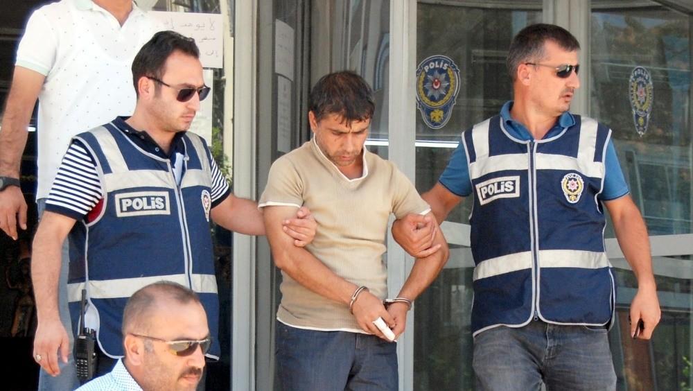 Police officers escort Kayapu0131nar after his arrest.