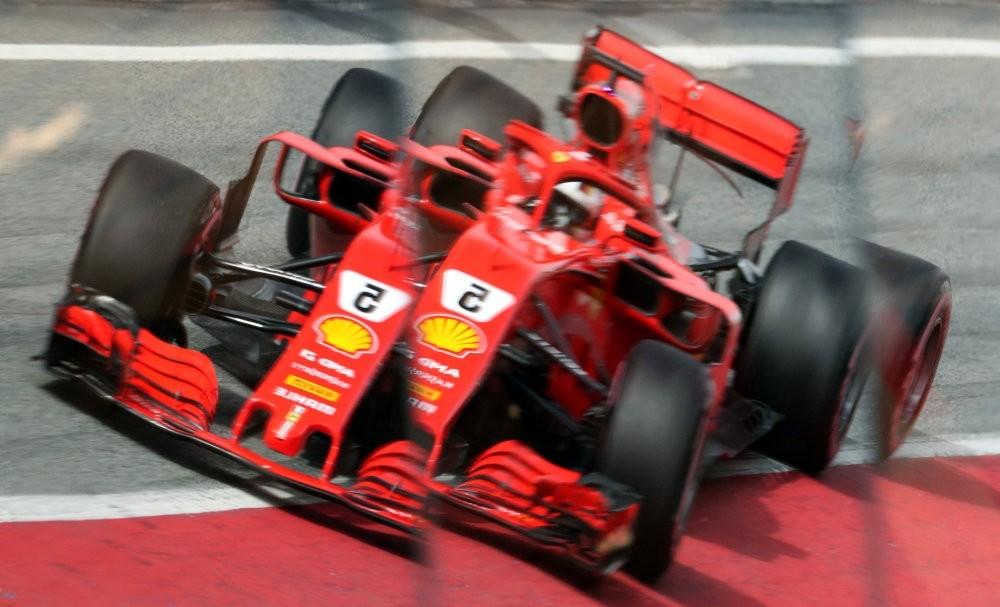 Ferrari's Sebastian Vettel is reflected in the pitlane during testing.