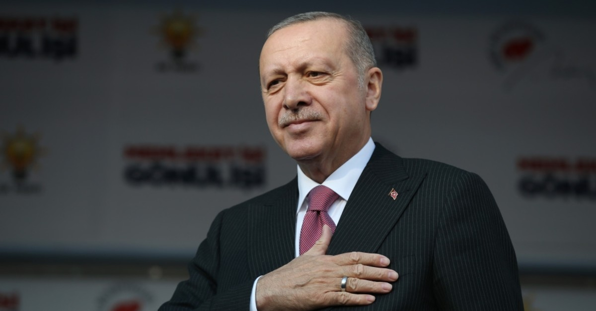 President Recep Tayyip Erdou011fan gestures to a large audience at a rally in northern Tokat province, Feb. 25, 2019.