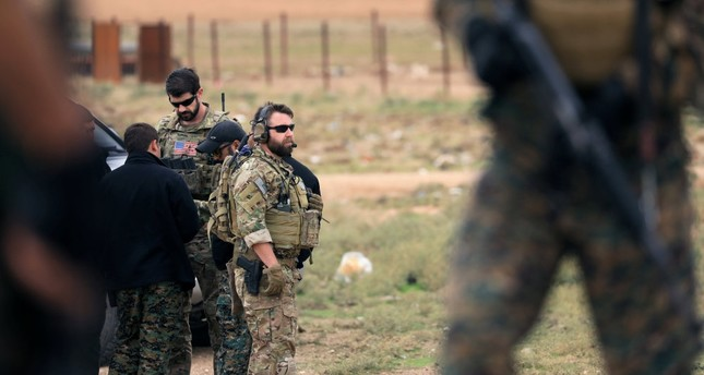 Members of the Syrian Democratic Forces SDF and U.S. troops are seen during a patrol near the Turkish border in Syria's Hasakah province, Nov. 4.