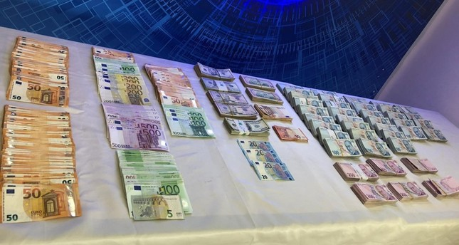 Photo shows the cash confiscated by Turkish police in operations in Ankara. AA Photo