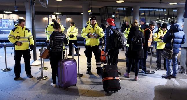 Security staff check ID's at Kastrups train station outside Copenhagen, Denmark, 04 January 2015. (EPA Photo)