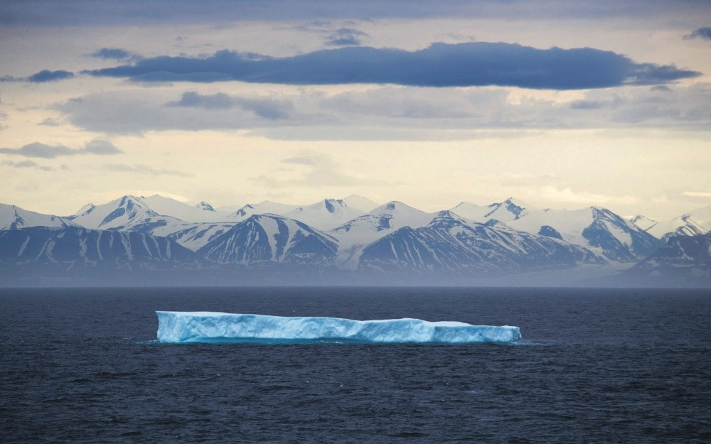 An iceberg floats past Bylot Island in the Canadian Arctic Archipelago.