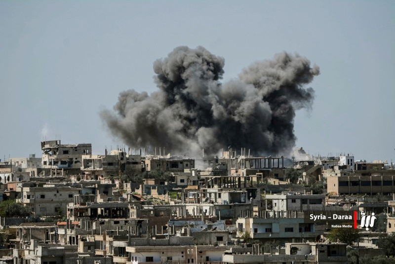 This Thursday, July 5, 2018 file photo provided by Nabaa Media, a Syrian opposition media outlet, shows smoke rising over buildings that were hit by Syrian government forces bombardment, in Daraa province, southern Syria. (AP Photo)