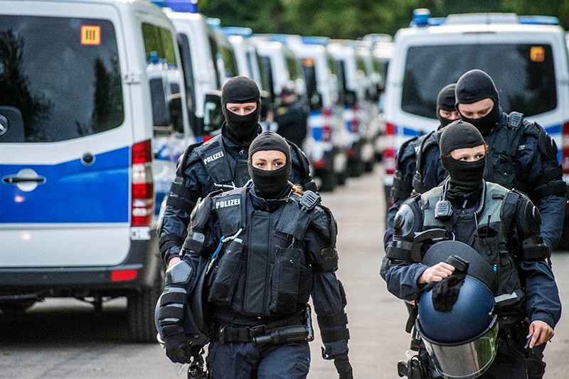 German police wearing masks at the reception center for refugees in Ellwangen, Germany, 03 May 2018. (EPA Photo)