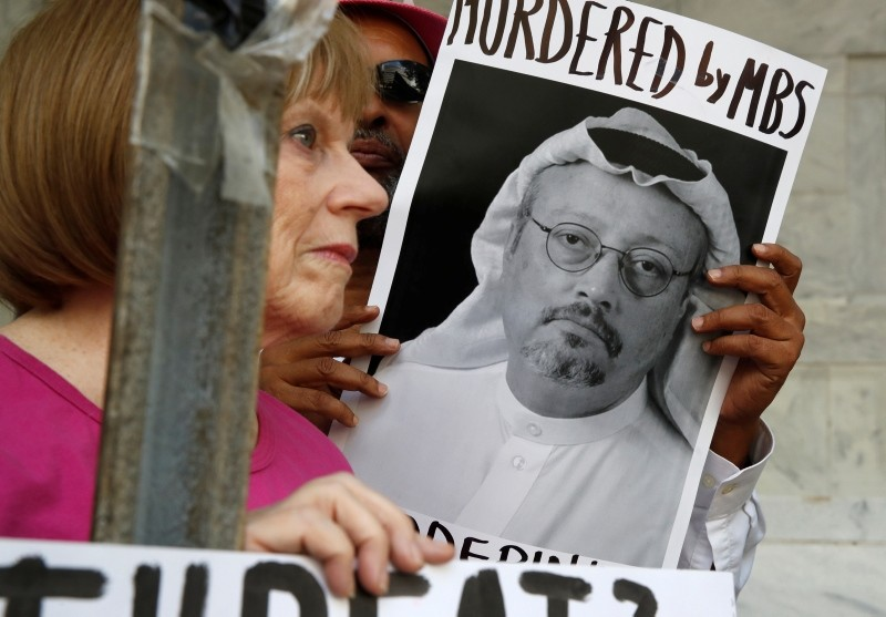 In this Oct. 10, 2018, file photo, people hold signs during a protest at the Embassy of Saudi Arabia about the disappearance of Saudi journalist Jamal Khashoggi, in Washington. (AP Photo)