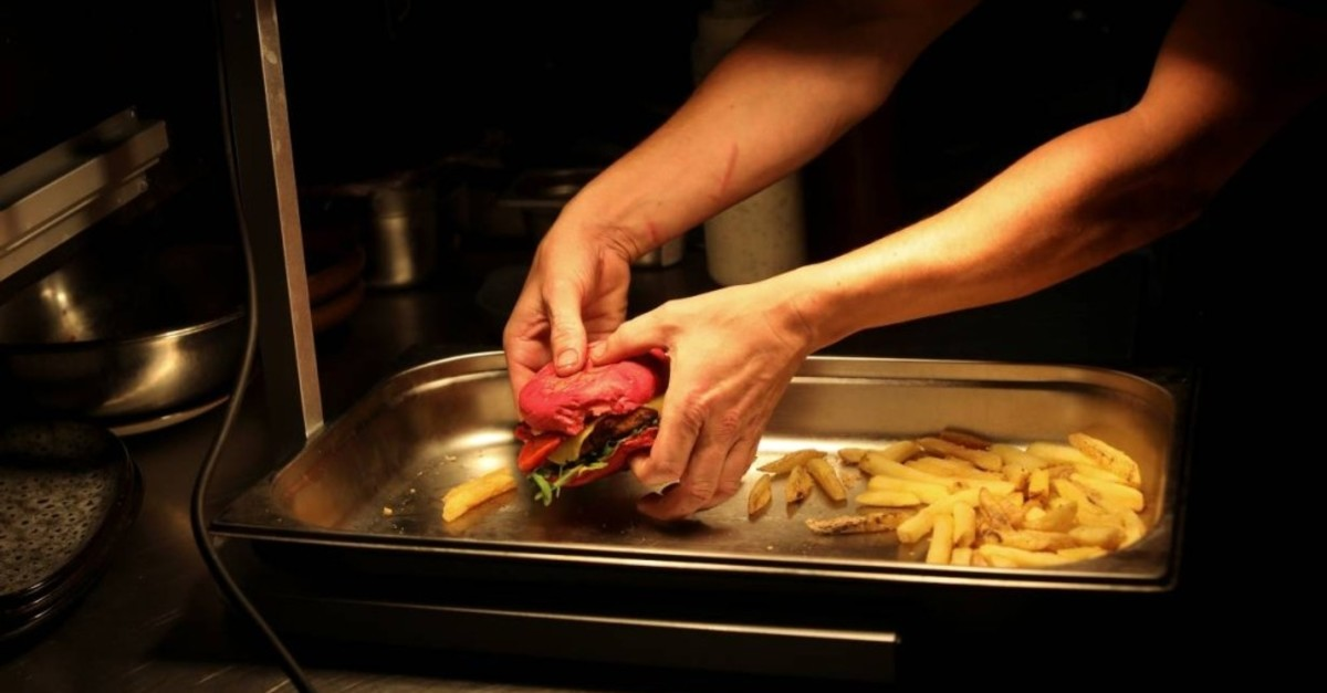 A chef prepares vegan food in the Green Grill section of the Green Vic, which is aiming to be the world's most ethical pub, in Shoreditch, London, Britain July 5, 2019. (Reuters Photo)