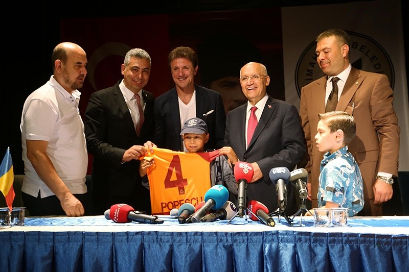 Former Galatasaray defender Gheorghe Popescu gives jersey to 11-year-old cancer patient Madalin Marcia Lordache at cermony in Ankara, Turkey. (AA Photo)