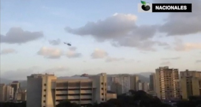 A police helicopter flies over Venezuela's Supreme Court building in Caracas June 27, 2017, in this still image taken from a video. (Caraota Handout Photo via Reuters)