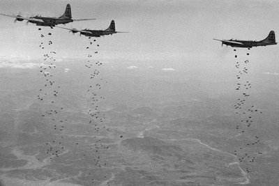 In this Jan. 18, 1951, file photo, Bomber Command planes of the U.S. Far East Air Forces rain tons of high demolition bombs in North Korea.