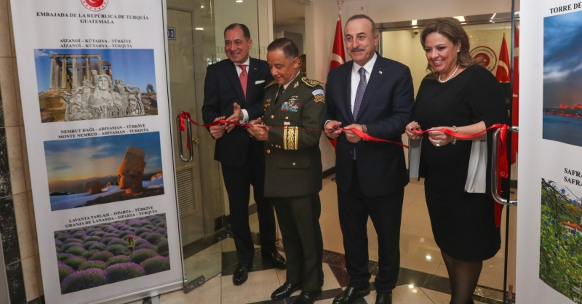 (L-R) Guatemalan Defense Minister and Chief of General Staff Miguel Ralda, Turkish FM Mevlu00fct u00c7avuu015fou011flu and his Guatemalan counterpart Sandra Jovel attend the inauguration ceremony for the new Turkish embassy building, on May 20, 2019. (AA Photo)