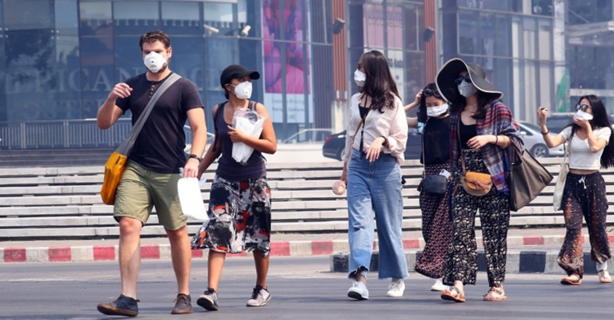 Tourists wear masks in Chiang Mai province, Thailand, Tuesday, April 2, 2019 (AP Photo)