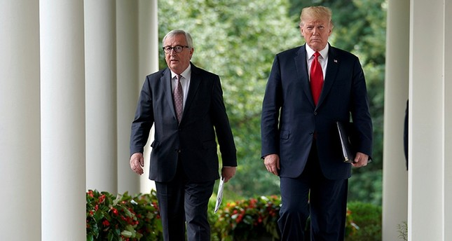 U.S. President Donald Trump and President of the European Commission Jean-Claude Juncker walk together before speaking about trade relations in the Rose Garden of the White House in Washington, U.S., July 25, 2018. (Reuters Photo)