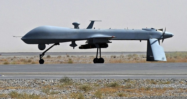 A file picture taken on June 13, 2010 shows a US Predator unmanned drone armed with a missile on the tarmac of Kandahar military airport in Afghanistan. AFP Photo
