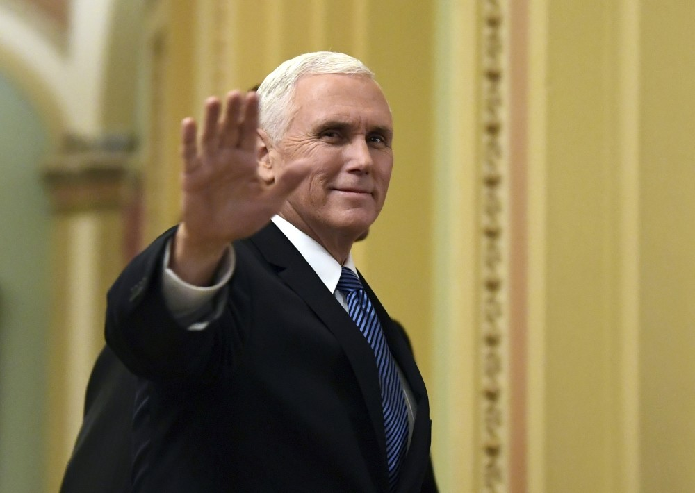 U.S. Vice President Mike Pence waves as he walks on Capitol Hill, Washington, Jan. 3. Pence is going to visit Egypt next week as part of a trip to the Middle East to discuss regional developments and the future of U.S.-Egyptian ties.