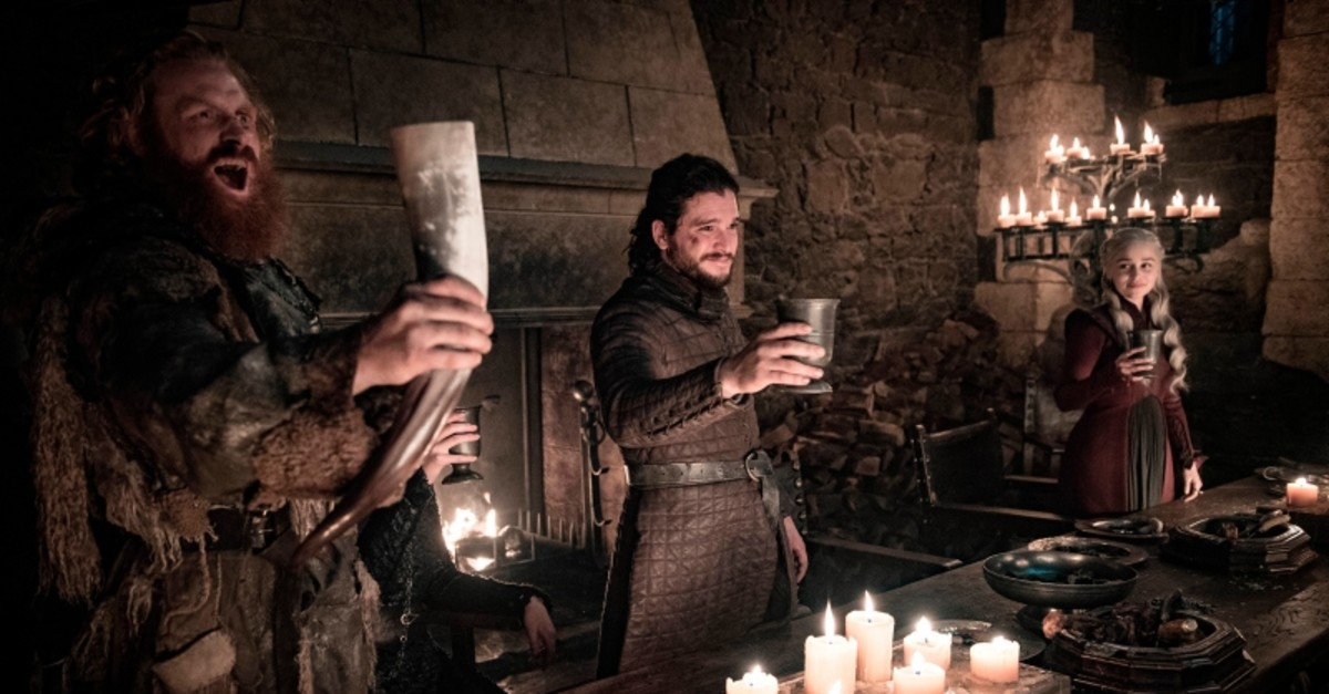 This image released by HBO shows Kristofer Hivju, from left, Kit Harington and Emilia Clarke in a scene from ,Game of Thrones., (HBO via AP Photo)