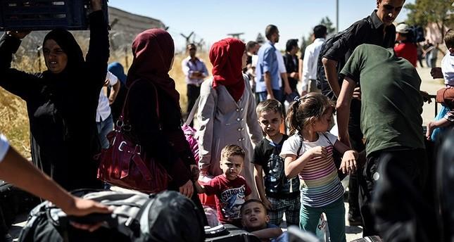 292 لاجئاً سورياً يعودون من تركيا إلى جرابلس المحررة من قبضة داعش