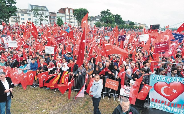 Turks attend a democracy rally in Germany's Cologne in August 2016 to protest the coup attempt by FETÖ. Hundreds of FETÖ members sought asylum in Germany after the attempt.
