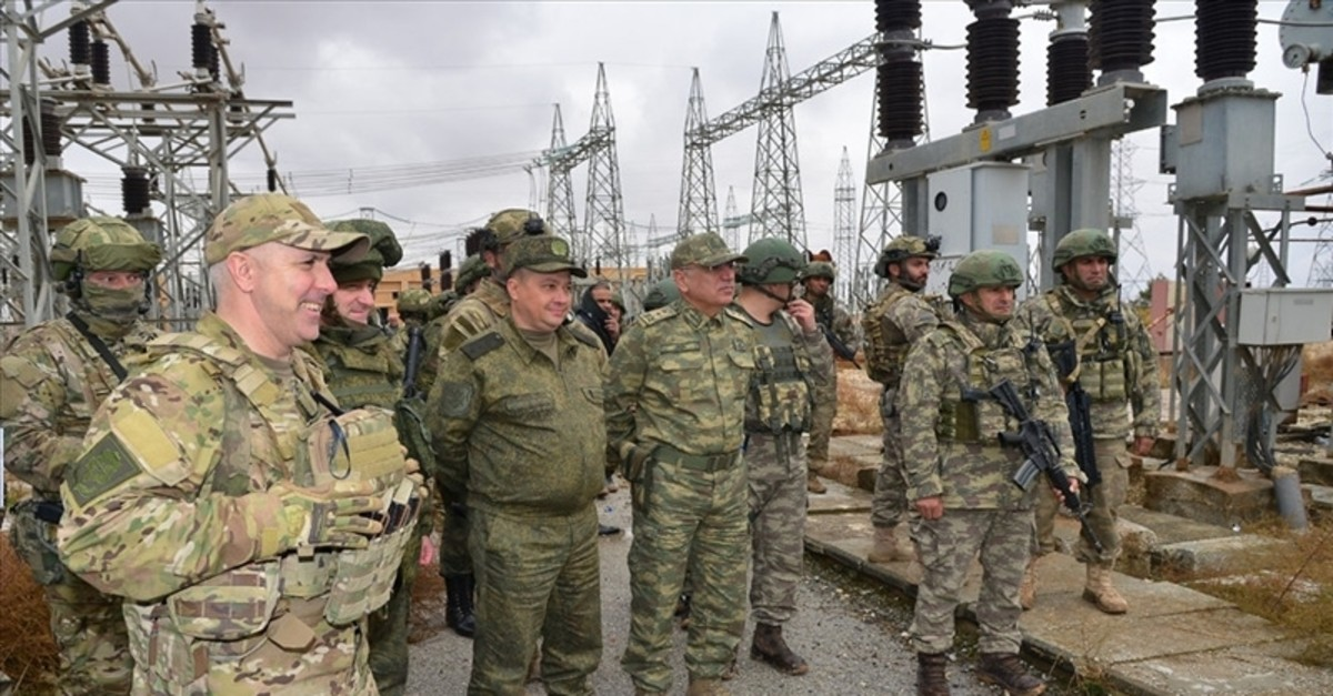 Turkish and Russian soldiers inspect a power facility at Ayn Isa village to provide electricity from the Tishrin Dam to Tel Abyad and Ras al-Ayn (AA Photo)