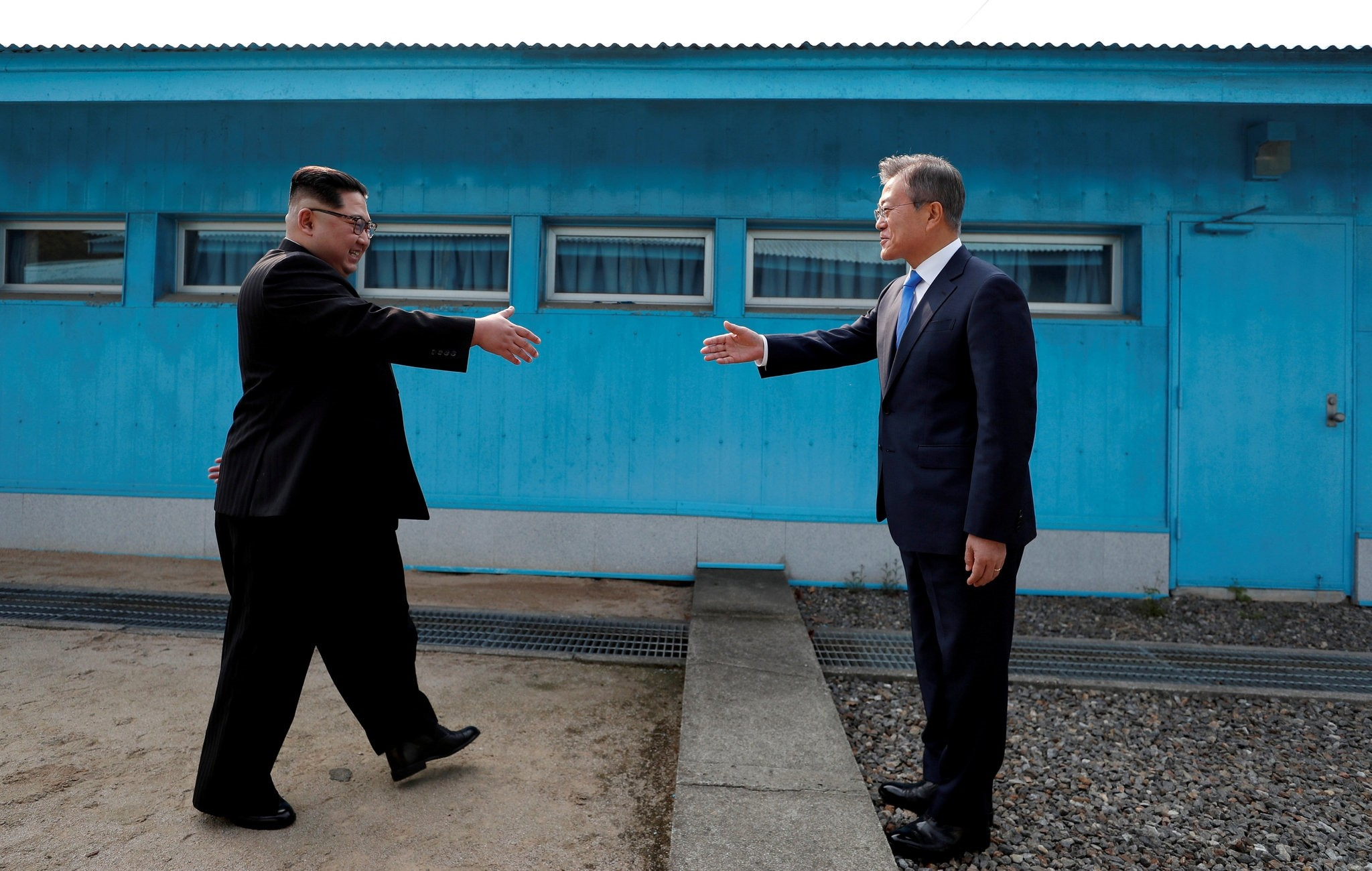 North Korean leader Kim Jong-un and  South Korean President Moon Jae-in shake hands at the truce village of Panmunjom inside the Demilitarized Zone separating the two Koreas, April 27.