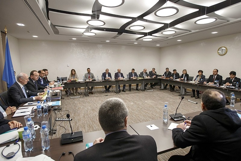 UN Special Envoy of the Secretary-General for Syria and Syria's main opposition High Negotiations Committee (HNC) attend a round of negotiation, during the Intra Syria talks, at the UN headquarters in Geneva, Switzerland, March 3, 2017. (AP Photo)