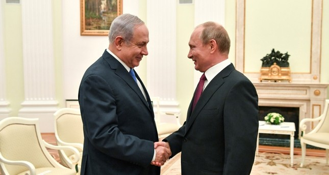 Russian President Vladimir Putin, right, shakes hands with Israeli Prime Minister Benjamin Netanyahu during their meeting at the Kremlin in Moscow, Wednesday, July 11, 2018. (AP Photo)