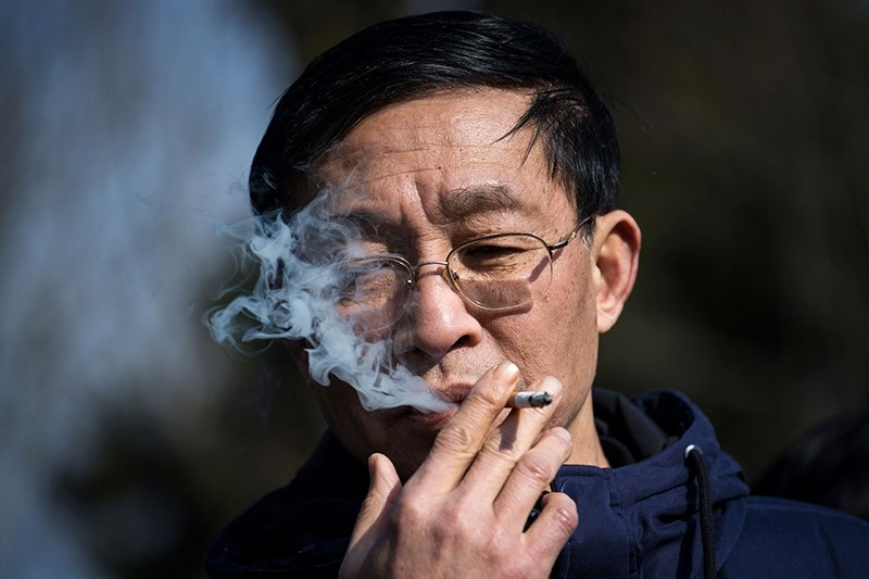 This file photo taken on January 31, 2017 shows a man smoking a cigarette in Shanghai. (AFP Photo)