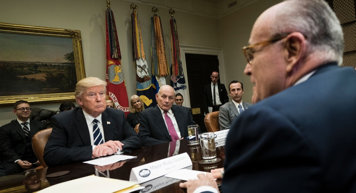 Rudy Giuliani (right) attends a meeting with U.S. President Donald Trump. (AFP Photo)