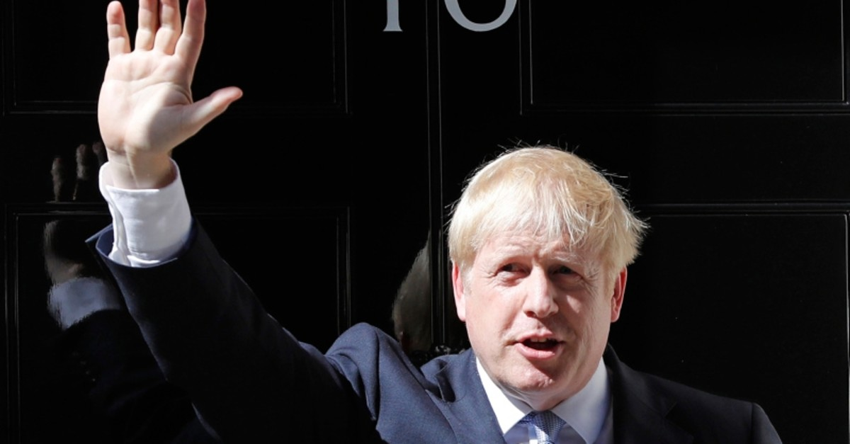 Britain's new Prime Minister Boris Johnson waves from the steps outside 10 Downing Street, London, Wednesday, July 24, 2019. (AP Photo)