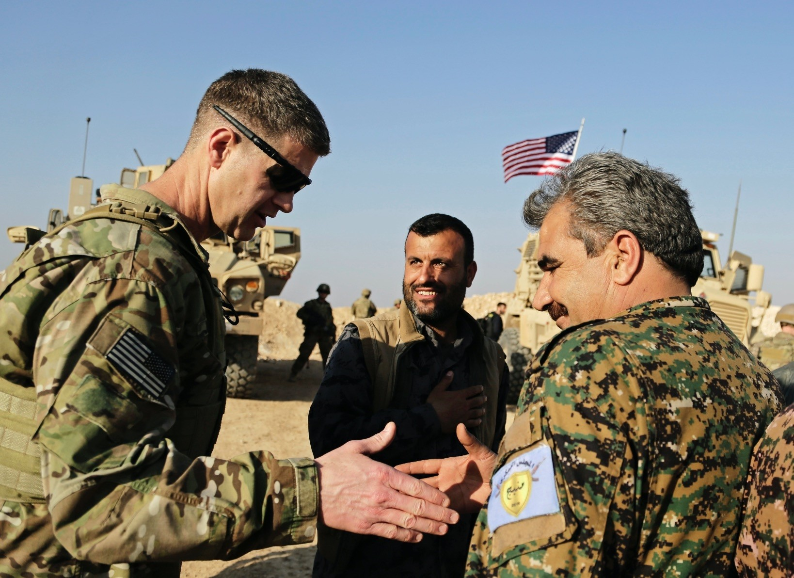 U.S. Army Maj. Gen. Jamie Jarrard (L), thanks the Manbij Military Council, which consists of YPG terrorists, including commander Muhammed Abu Adeel, during a visit to a small outpost near the town of Manbij, northern Syria, Feb. 7.