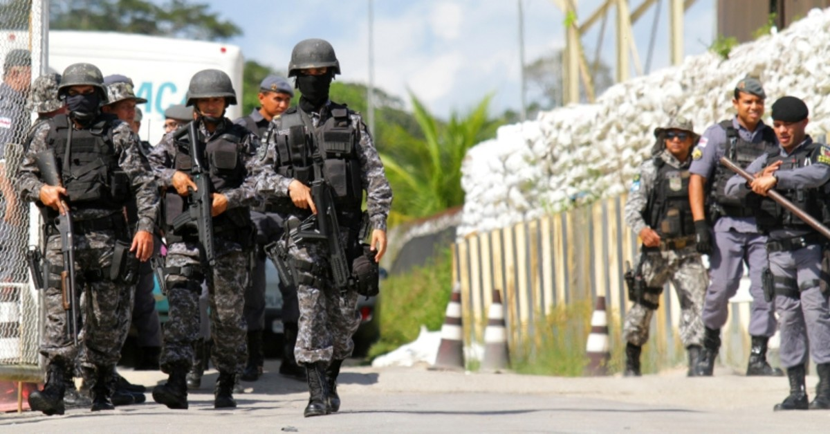 Policemen are seen during a riot in a prison in Brazilian state of Amazonas in Manaus, Brazil May 26, 2019. Picture taken May 26, 2019. (Reuters Photo)