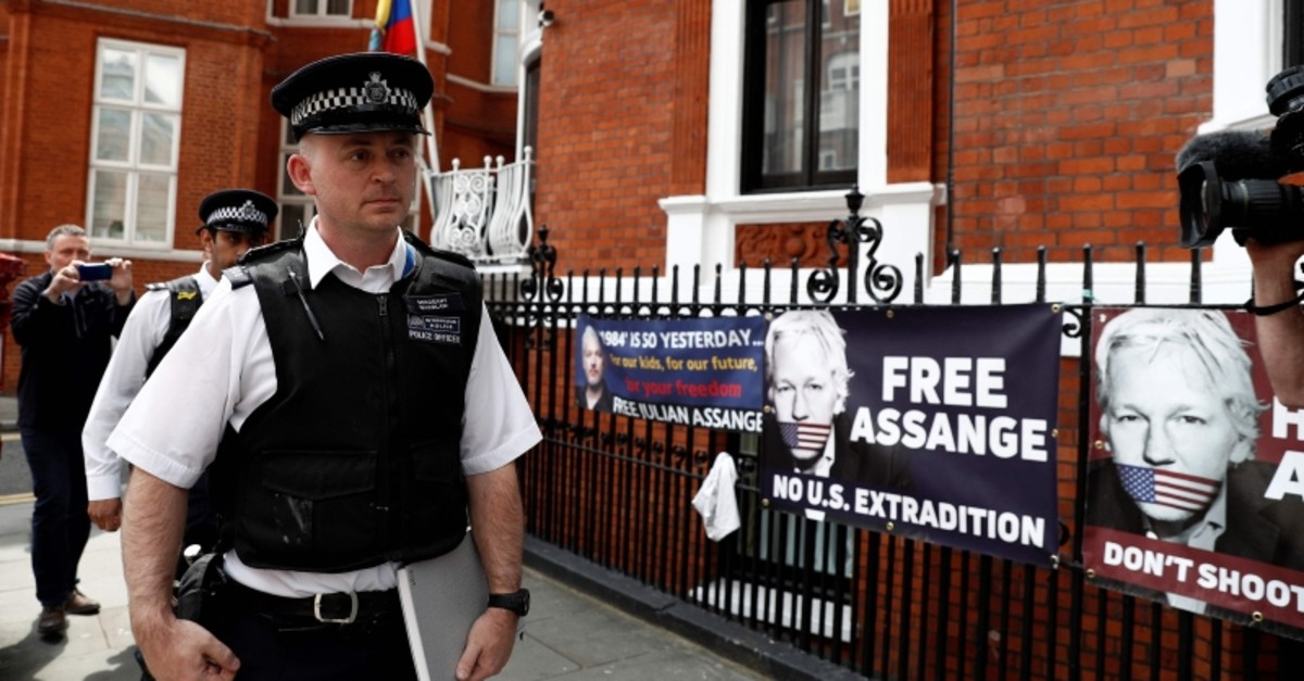 British police officers stand on duty outside the Embassy of Ecuador in London on May 20, 2019. (`AFP Photo)
