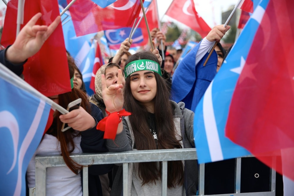 A girl giving a symbolic ,grey wolf, hand gesture, the sign of MHP's youth-branch, during a rally in Sakarya province, March 4, 2017.