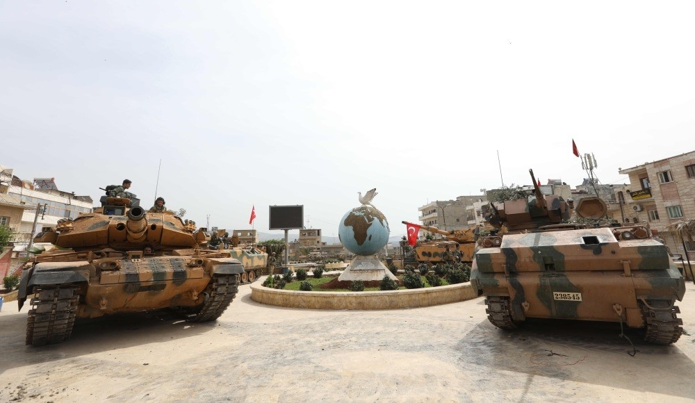 Turkish soldiers gather in the city of Afrin in northwestern Syria after taking control over it from the YPG in cooperation with the Free Syrian Army.