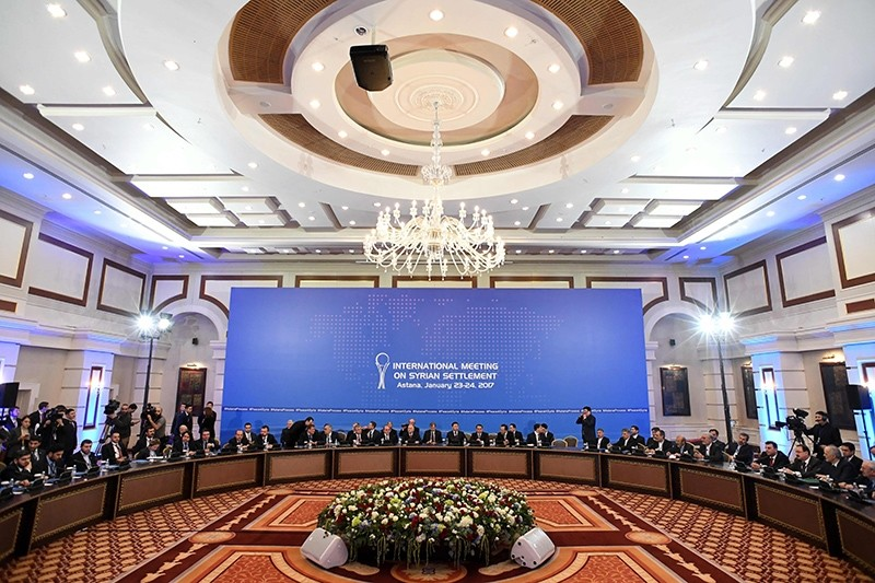 Representatives of the Assad regime and opposition groups along with other attendees take part in the first session of Syria peace talks at Rixos President Hotel,  Astana, Kazakhstan, Jan. 23, 2017. (AP Photo)