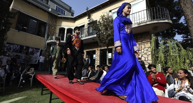 Men and women model clothing in rare Kabul catwalk
