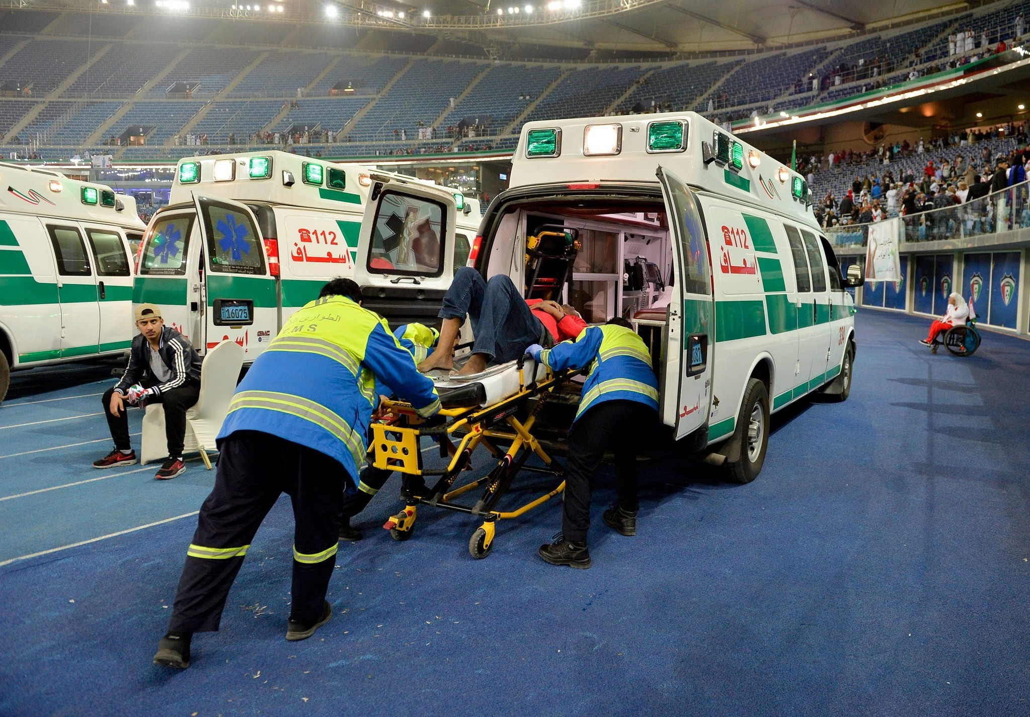 Medical staff treat injured fans after a glass barrier broke at the end of the Gulf Cup of Nations soccer Final match between Oman and UAE at Jaber Al-Ahmad International Stadium, Kuwait City, Kuwait, 05 January 2018. Oman won 5-4 in penelty shootout