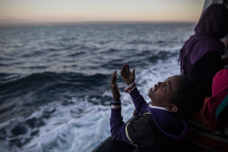 In this Friday Jan. 19, 2018 photo a child from Eritrea sings to celebrate his arrival to Europe aboard the Spanish NGO Proactiva Open Arms rescue vessel, Pozzallo, Sicily, Italy. (AP Photo)