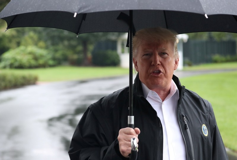 U.S. President Donald Trump talks to reporters as he departs for travel to tour hurricane damage in Florida from the White House in Washington, U.S., October 15, 2018. (REUTERS Photo)