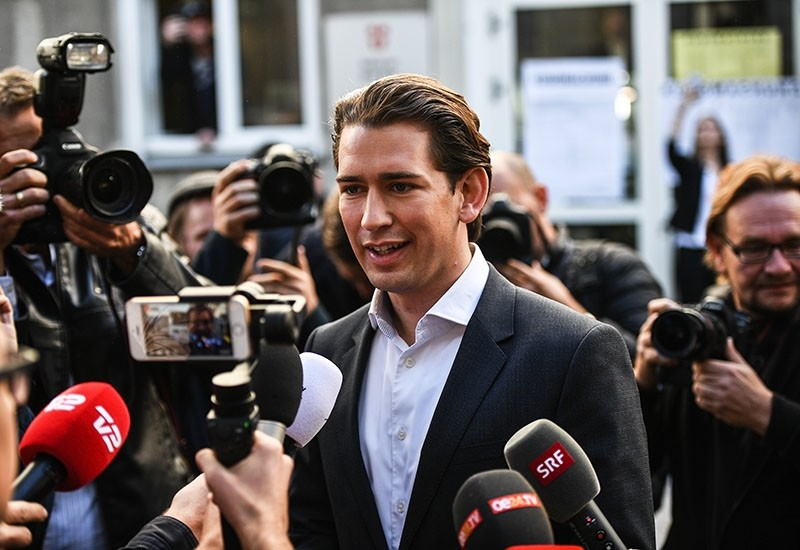 Austrian Foreign Minister Sebastian Kurz, the leader and top candidate of the Austrian Peoples Party (OeVP) answers media questions in front of a polling station after he cast his vote for the Austrian Federal Elections in Vienna, Austria (EPA Photo)