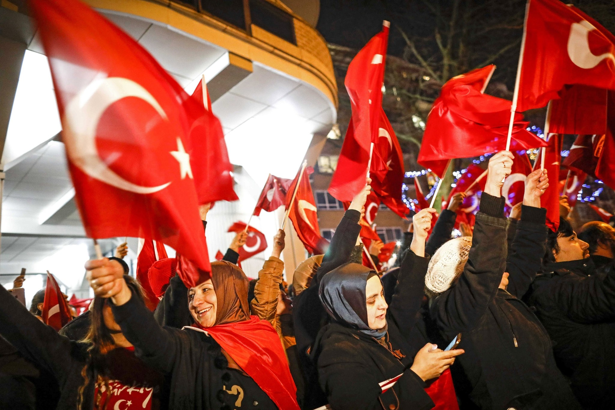 People wave Turkey flags as they protest outside the Turkish consulate in Rotterdam, the Netherlands, 11 March 2017. (EPA Photo)