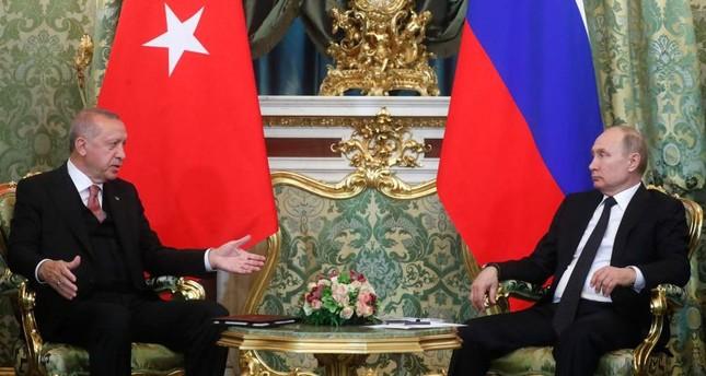 President Recep Tayyip Erdoğan (L) speaks with Russian President Vladimir Putin during their meeting at the Kremlin in Moscow, April 8, 2019.