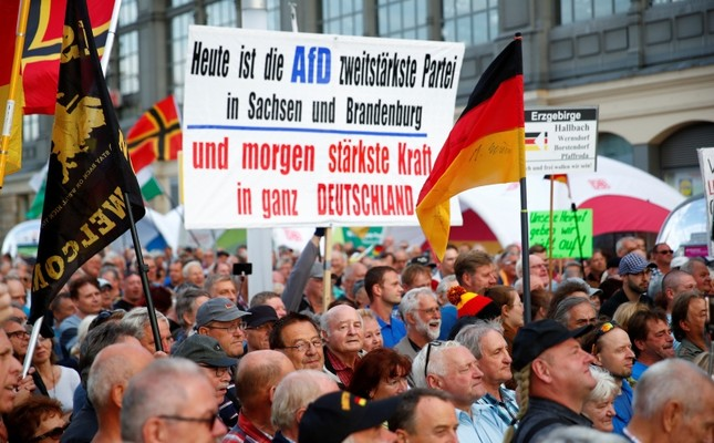 Supporters of the anti-Muslim movement PEGIDA rally following the federal state elections in Saxony during a demonstration at the main railway station in Dresden, Germany, Sept. 2, 2019. (Reuters Photo)
