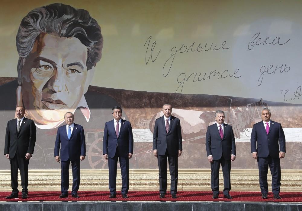 Azerbaijanu2019s Aliyev, Kazakhstanu2019s Nazarbayev, Kyrgyzstanu2019s Jeenbekov, President Erdou011fan, Uzbekistanu2019s Mirziyoyev and Hungaryu2019s  Orban pose for a photo in front of a portrait of Chingiz Aytmatov, a Kyrgyz author and diplomat