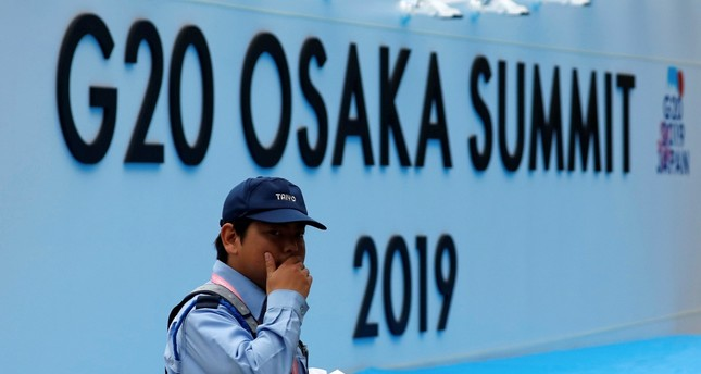 A security officer walks past the venue of the G20 leaders summit in Osaka, western Japan, June 26, 2019.